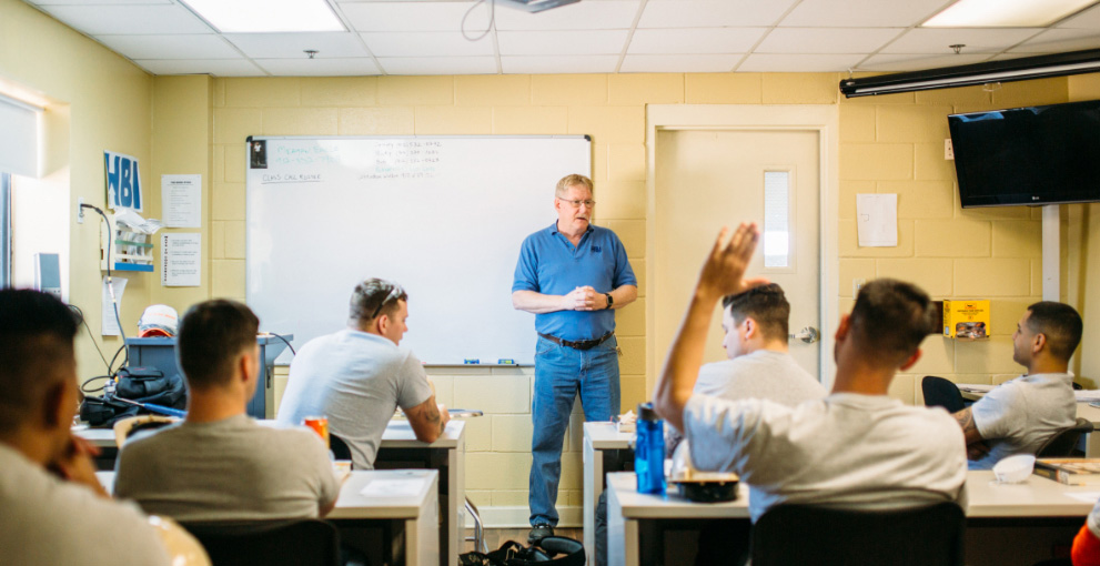 Student's supervisor explains something in a classroom